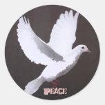 La paloma blanca de la paz etiqueta redonda