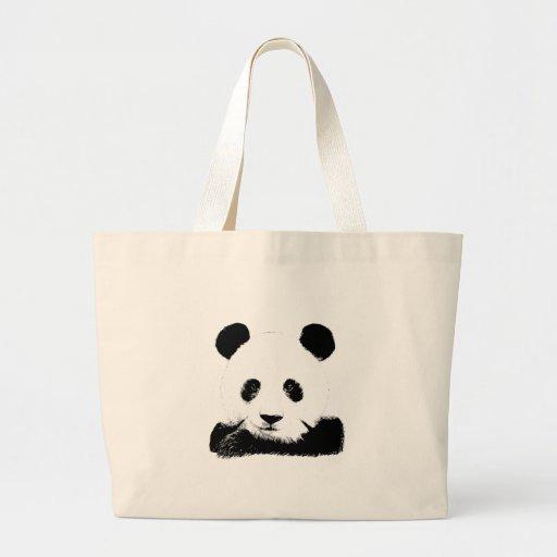 La panda mira a escondidas hacia fuera bolsas
