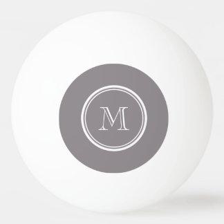 La parte alta gris de color topo coloreó pelota de tenis de mesa