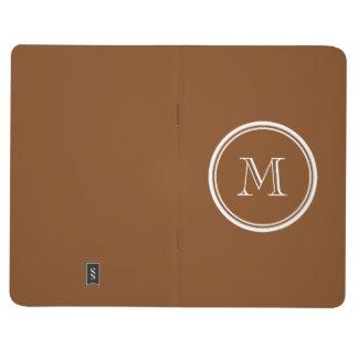 La parte alta pelirroja coloreó personalizado cuaderno grapado