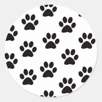 La pata del gato imprime a los pegatinas pegatina redonda