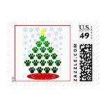 La pata imprime franqueo del árbol de navidad