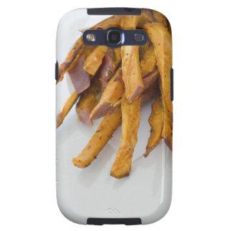 La patata dulce fríe en la bolsa de papel, cierre  galaxy s3 coberturas