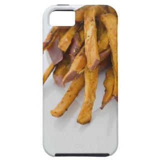 La patata dulce fríe en la bolsa de papel, cierre iPhone 5 funda