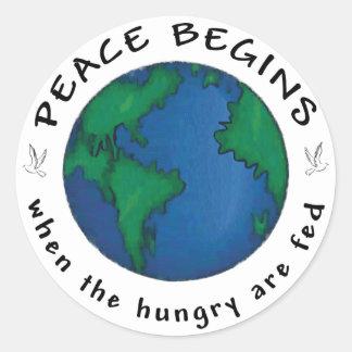 La paz comienza pegatina redonda