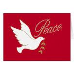 La paz del navidad se zambulló con la rama de tarjeta de felicitación