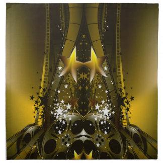 La película de oro aspa y las estrellas de un servilleta de papel