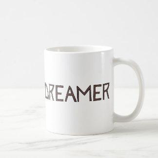 La pequeña línea logotipo del negro del soñador taza