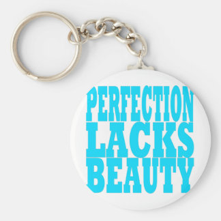 La perfección carece belleza llavero redondo tipo pin