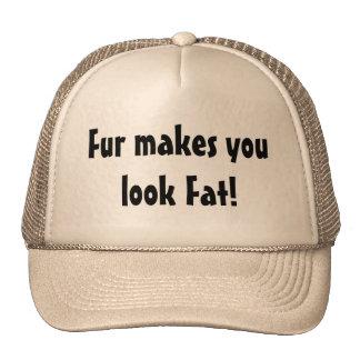 La piel hace que usted mira el gorra gordo