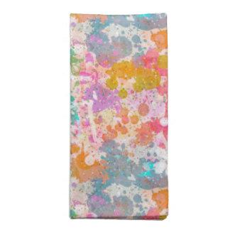 La pintura abstracta salpica multi coloreada silen servilletas de papel