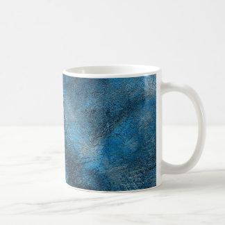 La pintura azul salpica diseño artístico taza