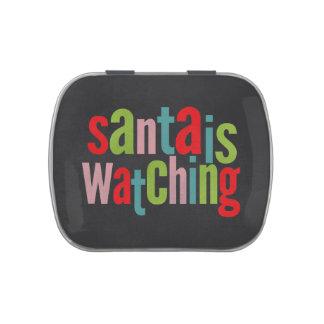 La pizarra Santa está mirando color del navidad Latas De Caramelos