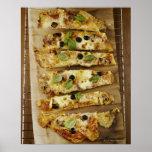 La pizza cortó en pedazos poster