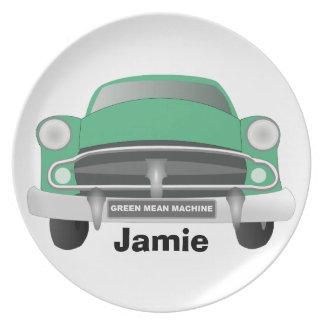La placa del muchacho retro malo verde del coche platos