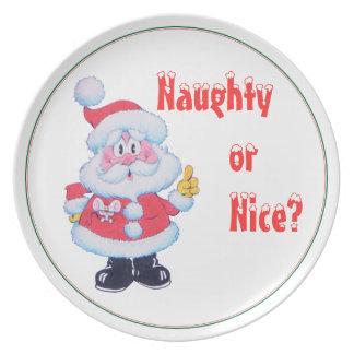 La placa traviesa o Niza de Santa del navidad Platos De Comidas