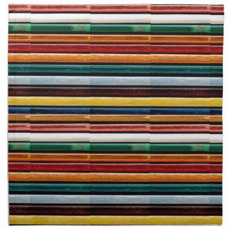 La plantilla colorida grabada en relieve de las servilleta