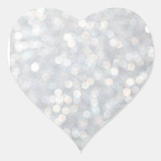 La plata chispea pegatina del corazón