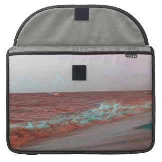 la playa agita el fondo rojo de la costa de la fundas macbook pro
