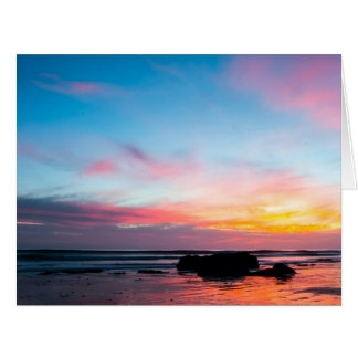 La playa de Handry de la puesta del sol Felicitacion