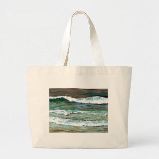 La playa de la comodidad del océano agita los rega bolsas de mano