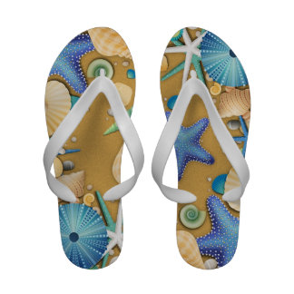 La playa descasca flips-flopes