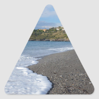 La playa en Scalea Pegatina Triangular