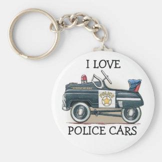 La policía Pedal llavero del coche del poli del co