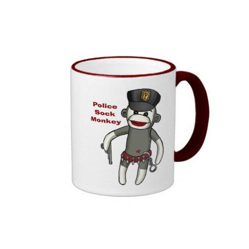 La policía pega el mono tazas de café