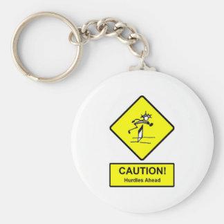 La precaución valla a continuación atletismo de la llavero redondo tipo pin