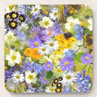 La primavera colorida florece la composición posavasos