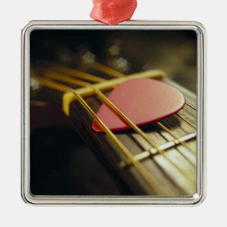 La púa de guitarra remetió adentro secuencias ornatos