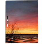 La puesta del sol del lago ice grande seca al tabl tableros blancos
