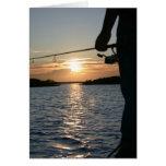 La puesta del sol del pescador tarjetón