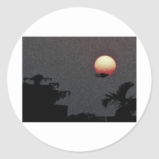 ¡La puesta del sol hermosa! Etiqueta Redonda