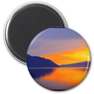 La puesta del sol púrpura en sistema del Pend Orie Imán Redondo 5 Cm