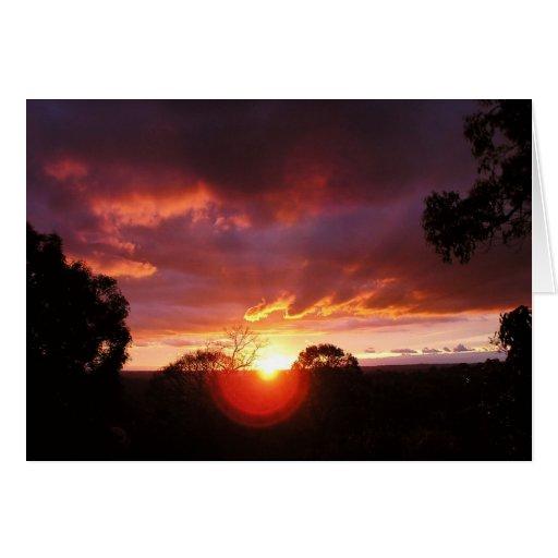 La puesta del sol ve la tarjeta