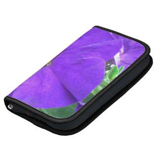 La púrpura florece a planificadores del folio del