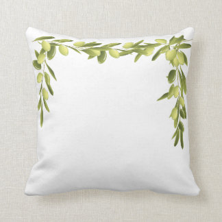 La rama de olivo en blanco sale de la almohada del
