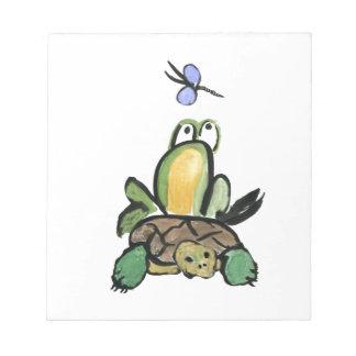 La rana coge un paseo en tortuga blocs de papel