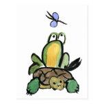 La rana coge un paseo en tortuga postales