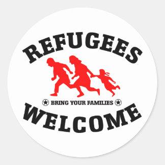 La recepción de los refugiados trae a sus familias pegatina redonda