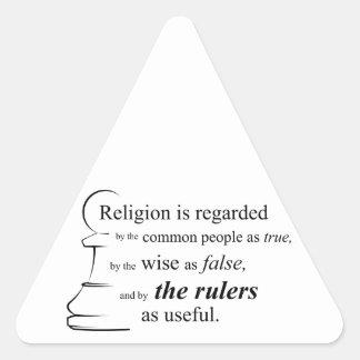 La religión es útil pegatina triangular