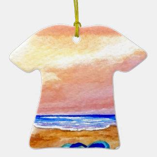La resaca ida del océano de la playa que nada agit ornamento de navidad