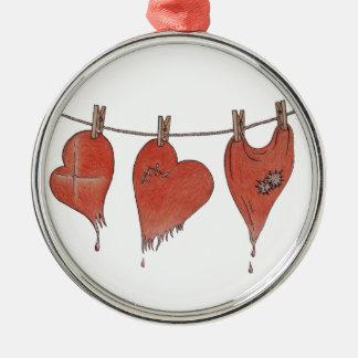 La resucitación de los corazones adorno navideño redondo de metal
