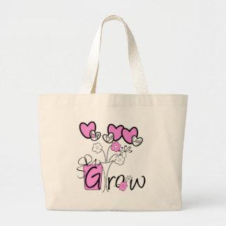 La risa viva del amor crece las camisetas y los re bolsa lienzo