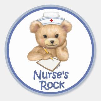La roca de la enfermera pegatina redonda