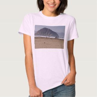 La roca de Morro vara a personas que practica surf Playeras