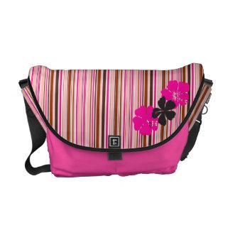 La rosa fuerte con los hibiscos florece el modelo  bolsa messenger
