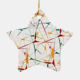 La salpicadura colorida forma el ornamento adorno navideño de cerámica en forma de estrella